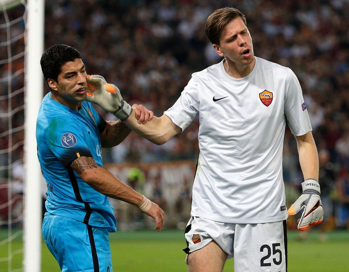 AS Roma's goalkeeper Wojciech Szczęsnyreacts against Barcelona's Luis Suarez. (Photo: Reuters)