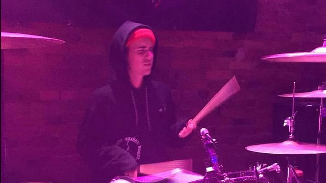 """Justin Bieber playing the drum set at a bar in Angola, Indiana (Photo: <a href=""""https://www.facebook.com/thevenuedtangola/photos/a.158347571037448.1073741827.158272987711573/436328659906003/?type=1&amp;theater"""">Facebook/ The Venue Angola</a>)"""