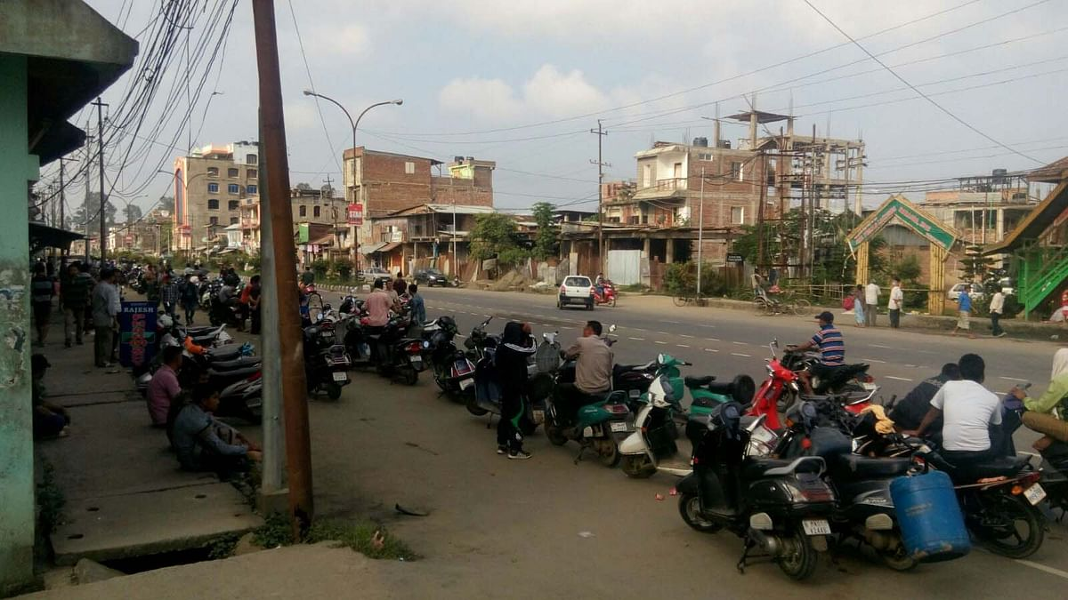 A line of bikers waiting to get their supply of petrol. (Photo: Sunzu Bachaspatimayum)