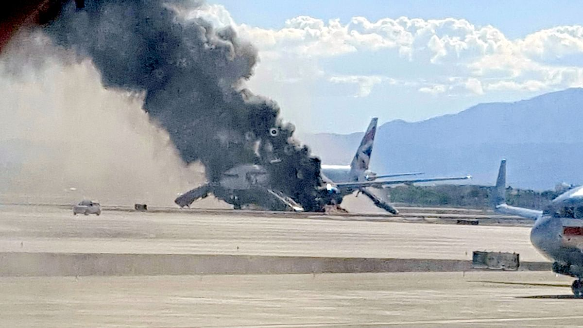 Smoke billows out from the plane that caught fire at McCarren International Airport, Tuesday, in Las Vegas. (Photo: AP/Eric Hays)