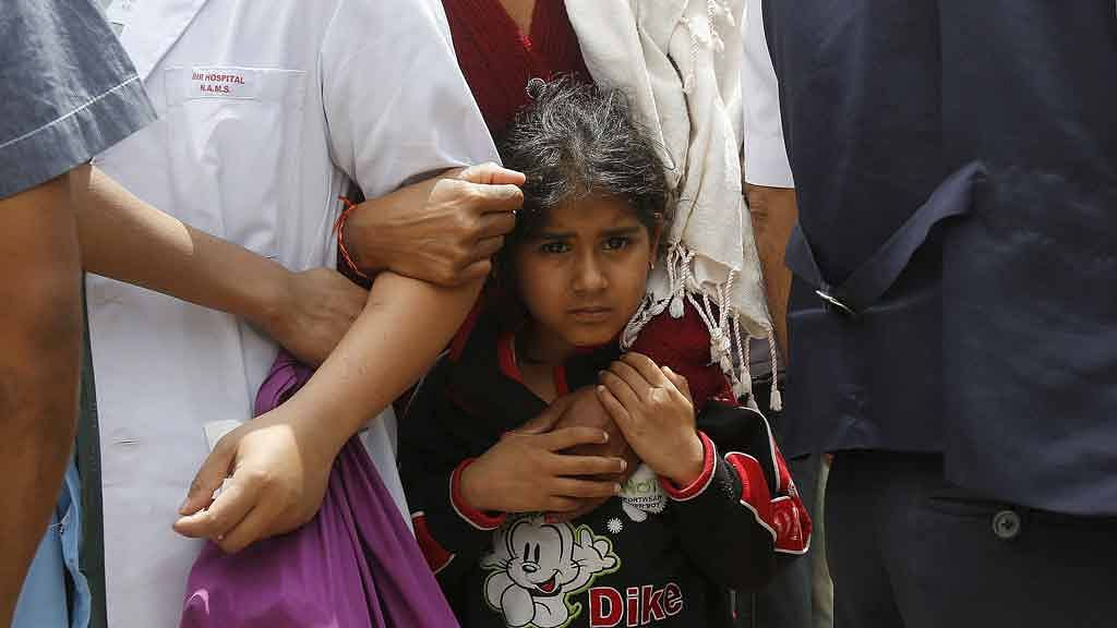 April 26, 2015: A girl holds her mother as they stand outside a hospital during a strong aftershock after an earthquake in Kathmandu, a day after the 7.9 magnitude earthquake struck Nepal. (Photo: Reuters)