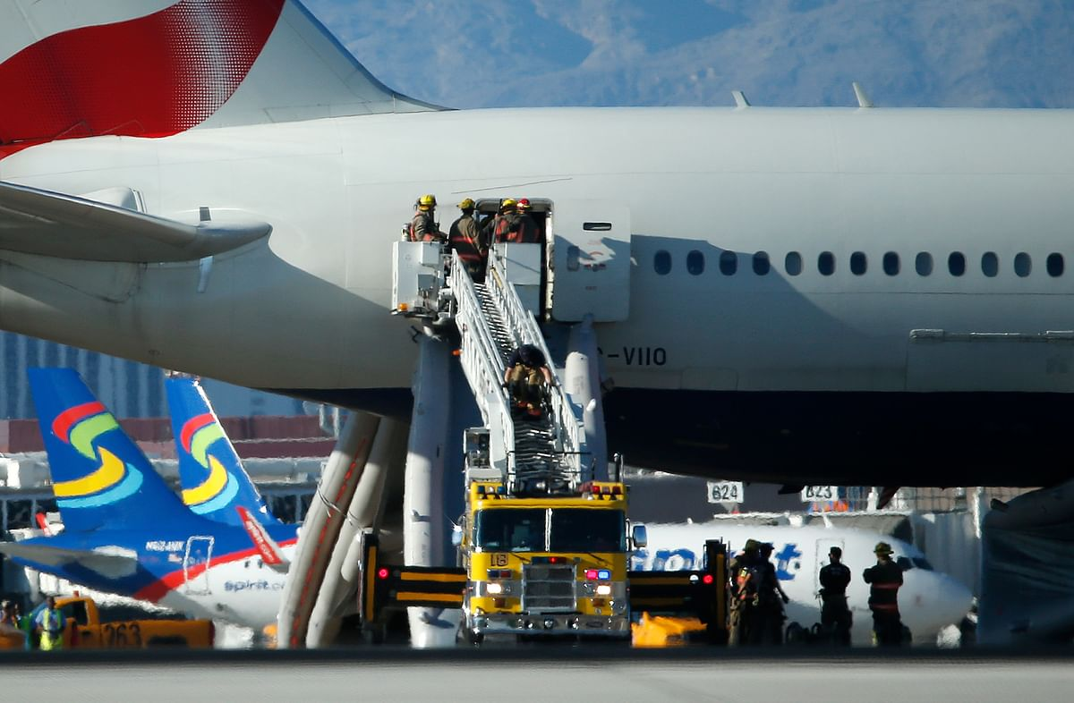 Firefighters enter theplane that caught fire at McCarren International Airport Tuesday, Sept. 8, 2015, in Las Vegas. (Photo: AP)