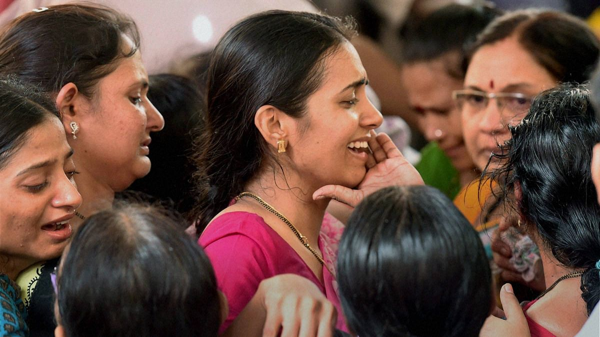 Wife Preeti and other family members wail during the funeral of Parag Sawant.