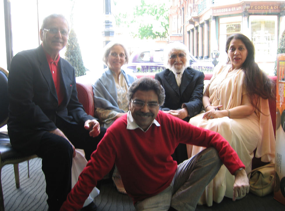 Husain with his friends and Khalid Mohamed(centre) in Royal China, London.