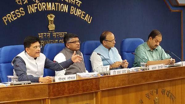 "(L-R) Piyush Goyal, RS Prasad, Arun Jaitley at the cabinet briefing. (Photo: <a href=""https://twitter.com/DG_PIB/status/641526117577261056"">Twitter.com/@DG_PIB</a>)"