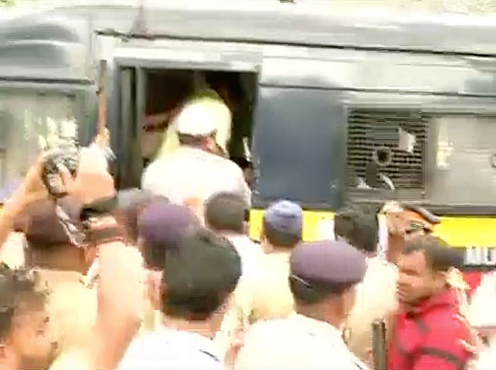 Police taking the MNs workers away. (Photo: ANI)