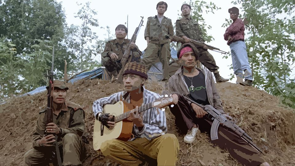 Members of the rebel outfit NSCN(K) parade around their camps, armed with guns and guitars. (Photo: Reuters)