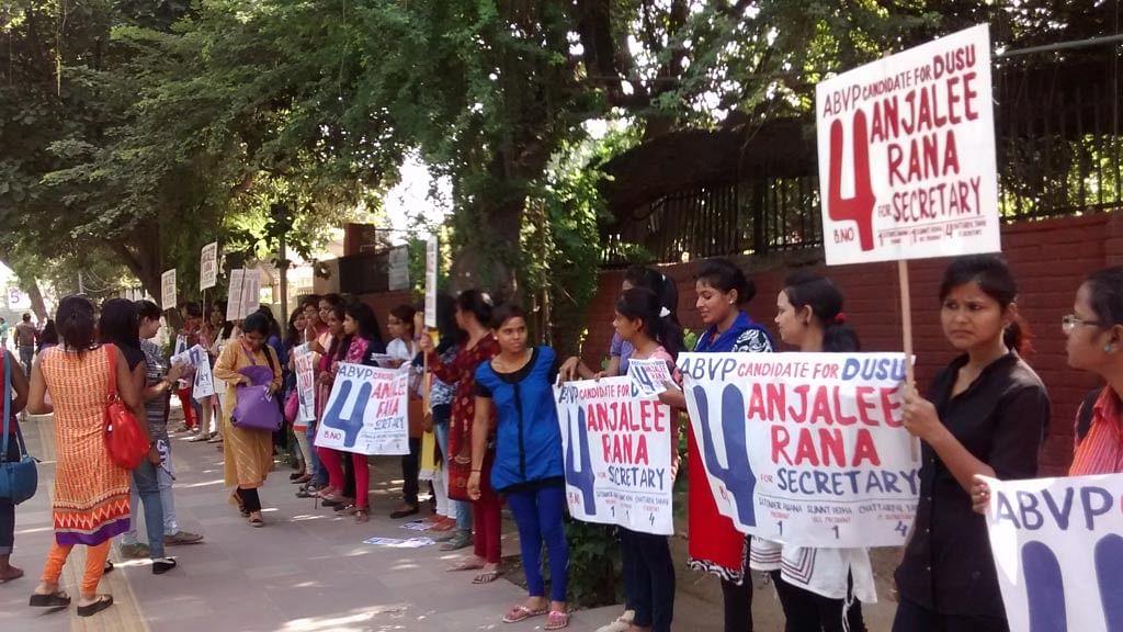 ABVP volunteers campaign near Delhi University's metro station. (Photo: Neha Yadav/The Quint)