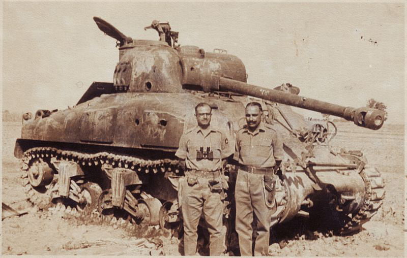 Indian army officers witha destroyed Pakistani tank in Sept '65 (Photo: Wickimedia Commons)