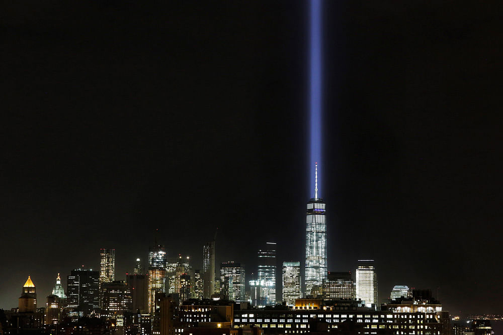 The Tribute in Light illuminates the sky behind One World Trade Center. (Photo: AP)