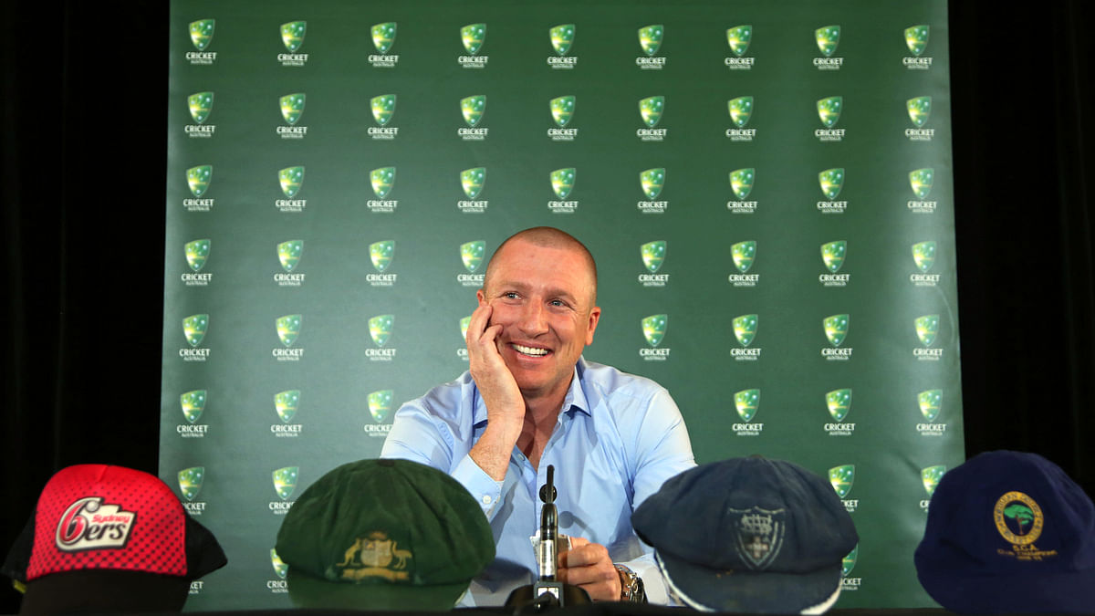 Australian cricket player Brad Haddin smiles as he announces his retirement from test and domestic first-class cricket in Sydney in Wednesday. (Photo: AP)