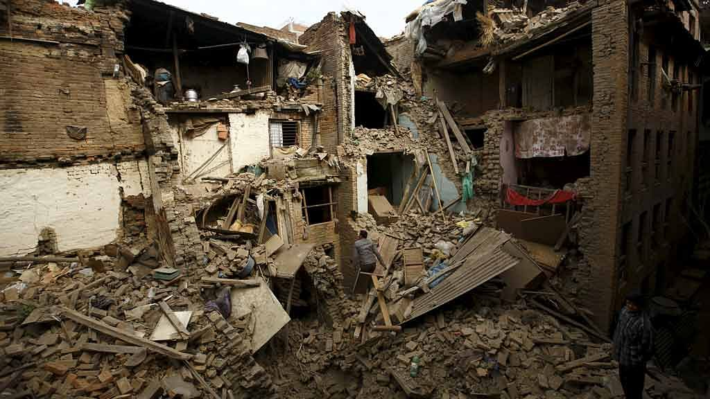 April 26, 2015: People search for family members trapped inside collapsed houses a day after the earthquake in Bhaktapur, Nepal (Photo: Reuters)