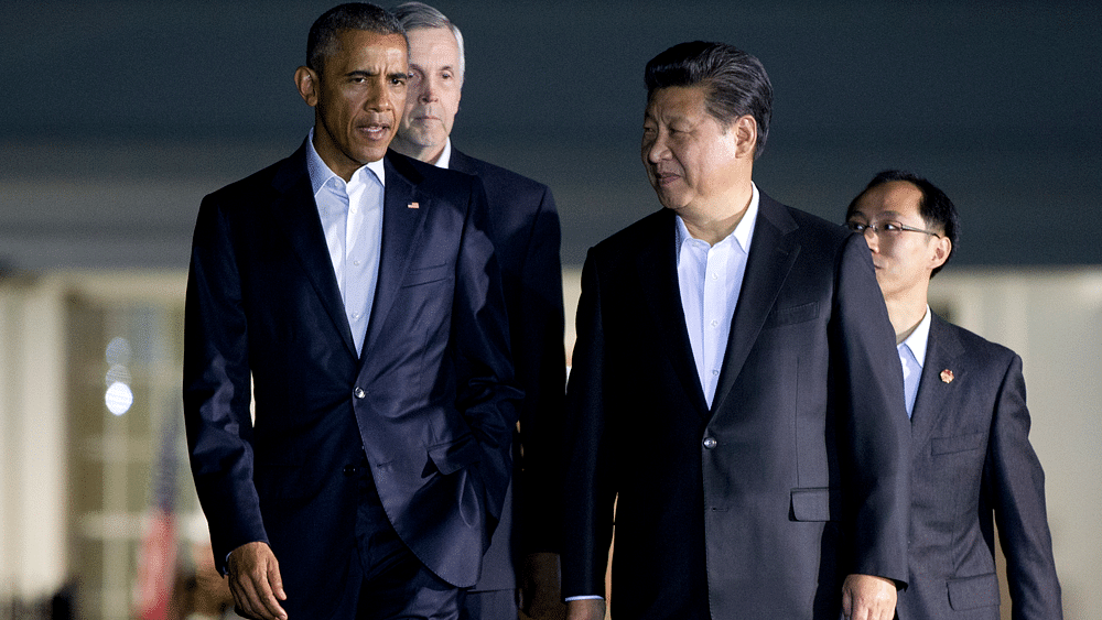 President Barack Obama and Chinese President Xi Jinpingwalk from the West Wing of the White House in Washington, Thursday, Sept. 24, 2015. (Photo: AP)