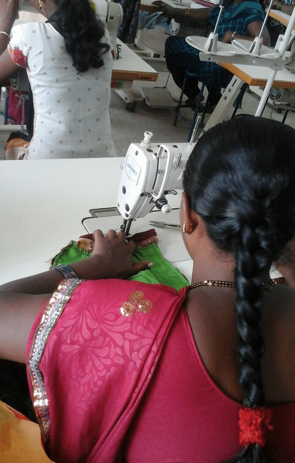 A woman hard at work, sewing the threads of her freedom. (Photo Courtesy: Threads of Freedom)