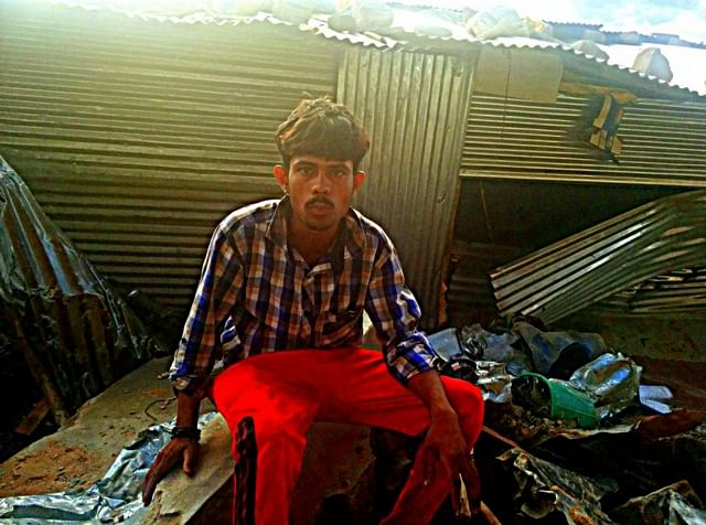 24-year old Sumith and his shed in the background. (Photo courtesy:<i>The News Minute</i>)