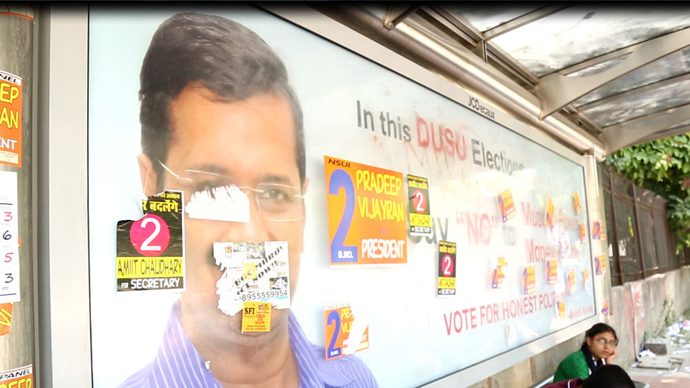 CYSS poster at a bus stop outside Kirori Mal College (KMC). (Screenshot: The Quint)
