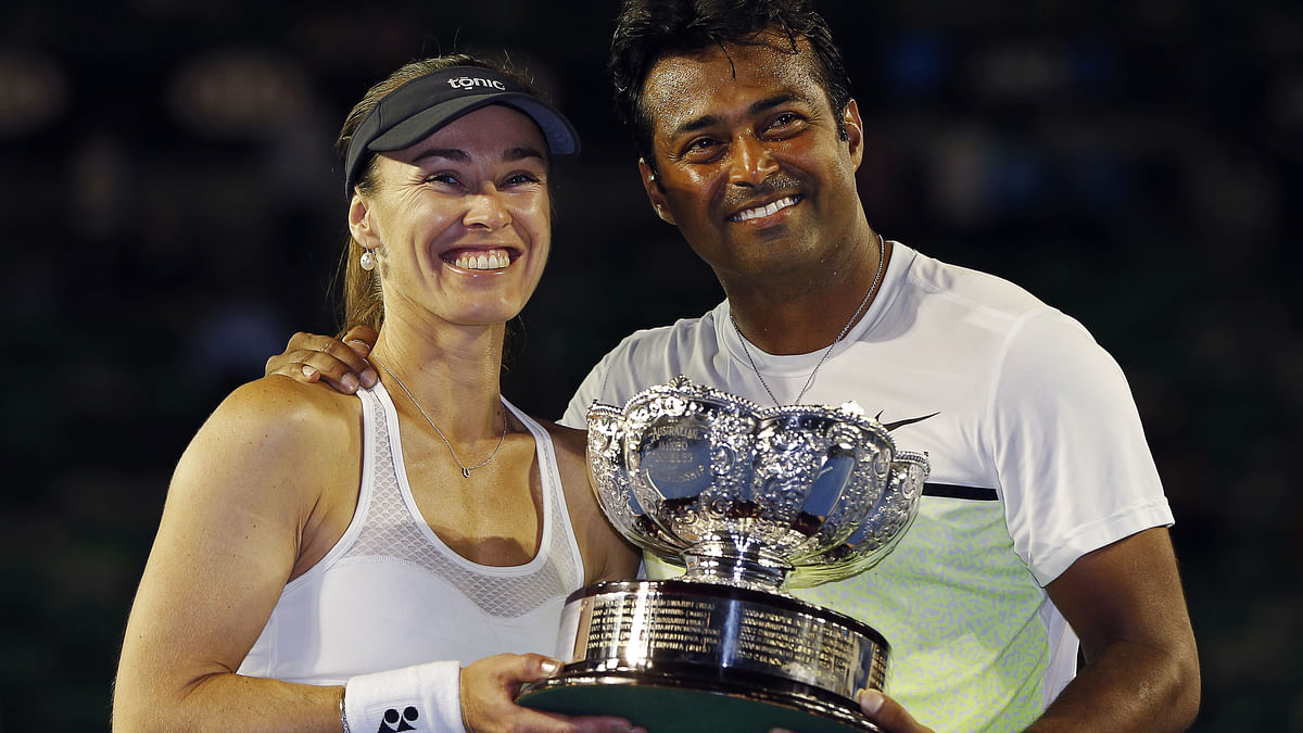 Martina Hingis and Leander Paes pose with the Mixed Doubles Australian Open trophy earlier this year. (Photo: Reuters)