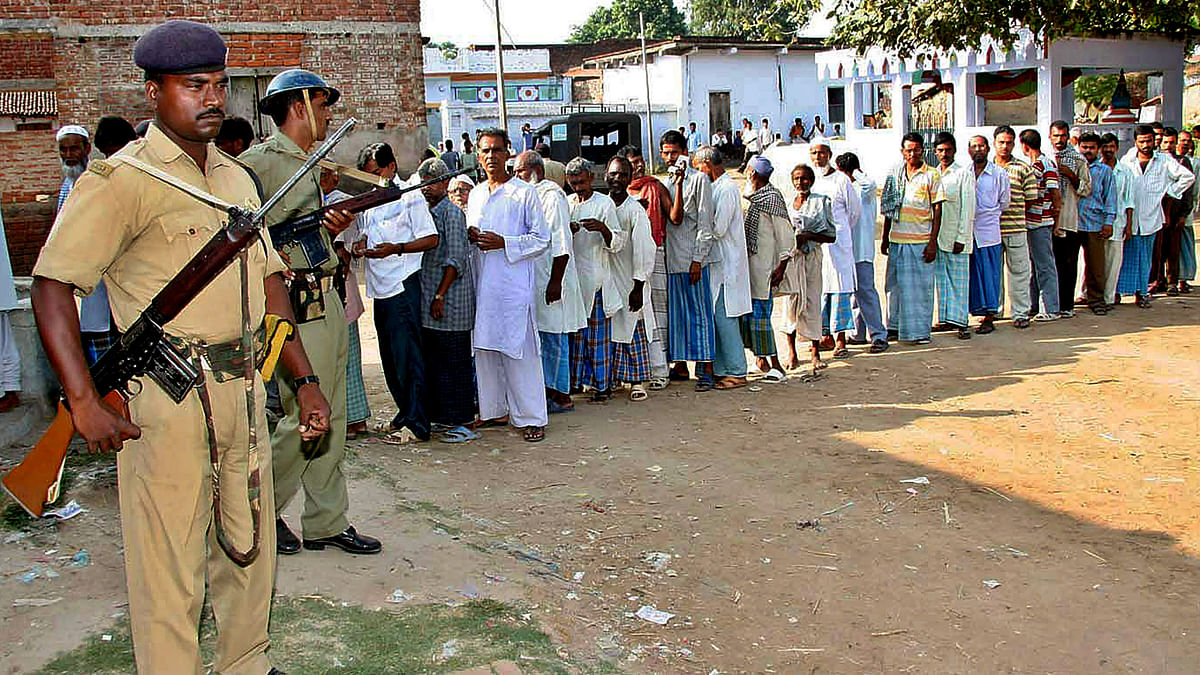 Voters queue outside a poll booth in Bihar. (Photo: Reuters)