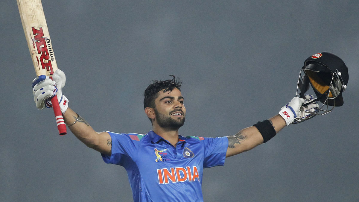 Virat Kohli raises his bat after scoring a century against Bangladesh in the Asia Cup in 2014. (Photo: Reuters)