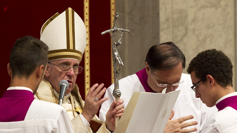A file photo of Pope Francis delivering his blessing at the end of a prayer  at the Vatican.