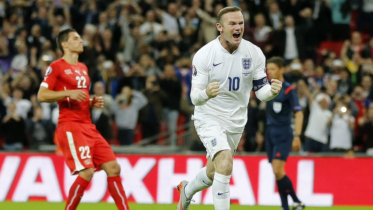 Wayne Rooney celebrates after scoring his 50th international goal for England.  (Photo: AP)