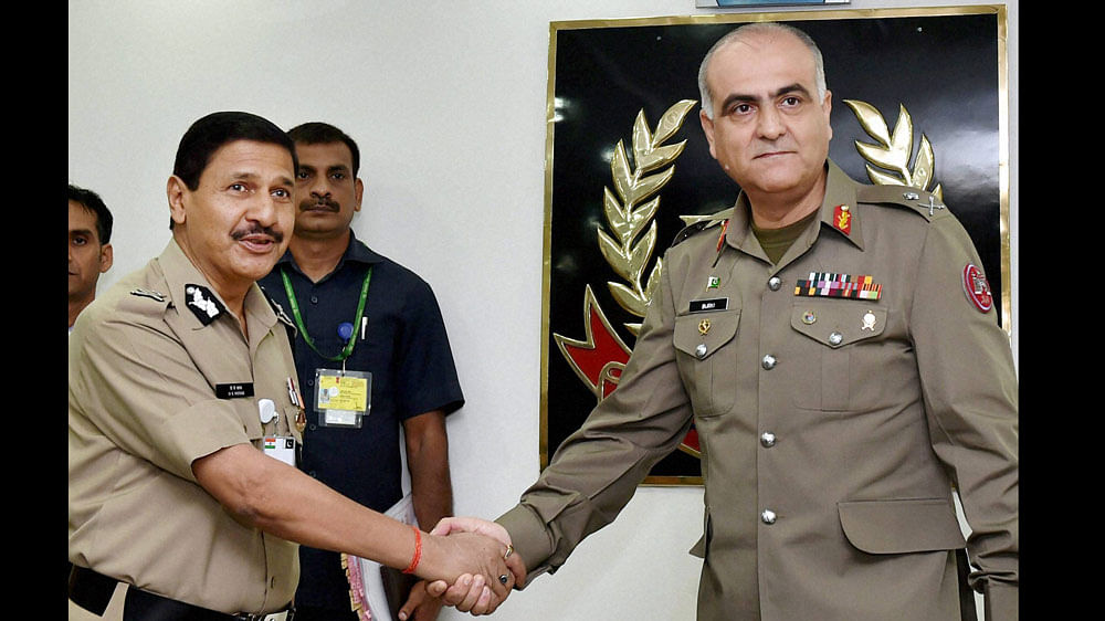 BSF Director General DK Pathak shakes hands with Pakistani Rangers DG, Major General Umar Farooq Burki. (Photo: PTI)