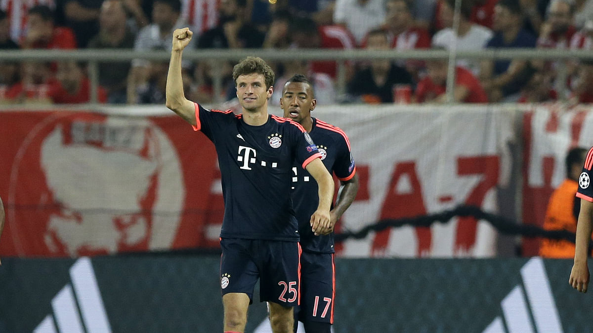 Thomas Mueller celebrates after scoring his side's opening goal against Olympiakos in their Champions League group match. (Photo: AP)