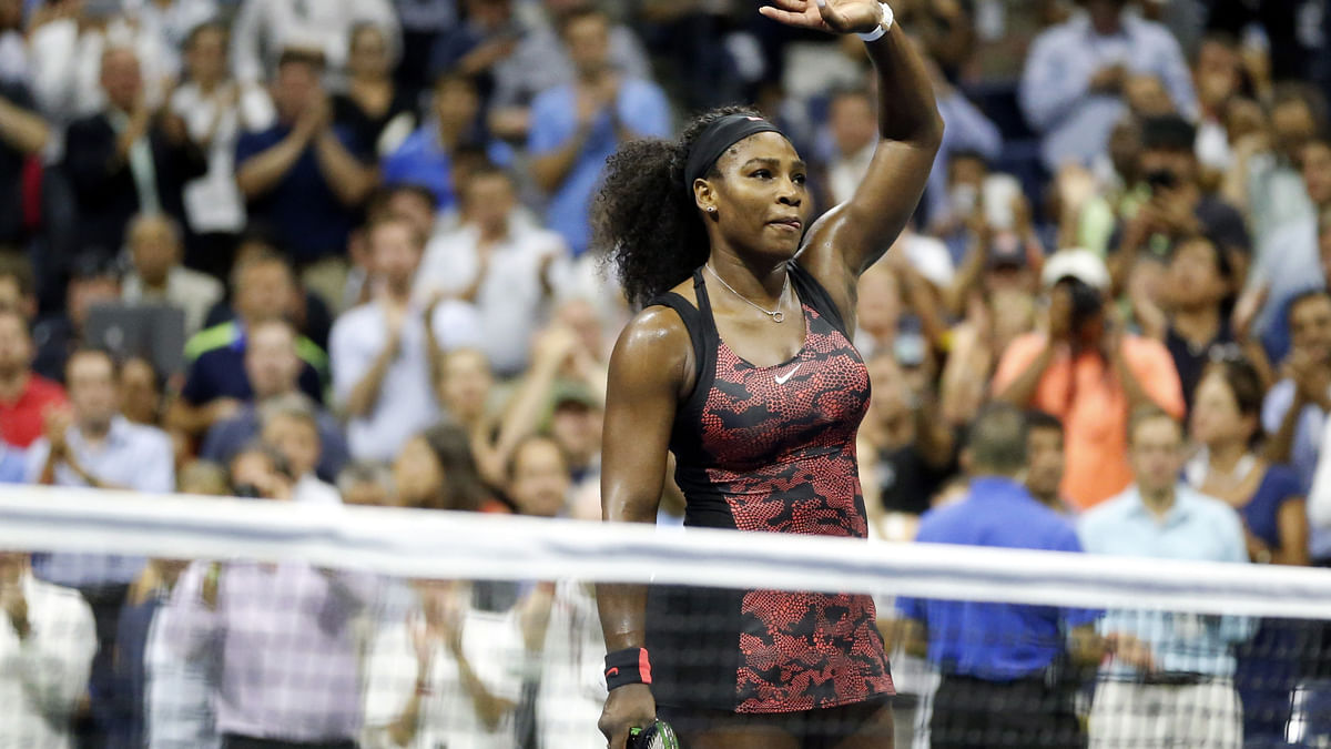 Serena Williams waves to the crowd after beating her sister Venus in the quarter-final of the US Open on Tuesday. (Photo: AP)