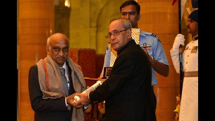 "ISRO Chairman AS Kiran Kumar receiving the honour. (Photo: <a href=""https://twitter.com/RashtrapatiBhvn"">Twitter</a>)"