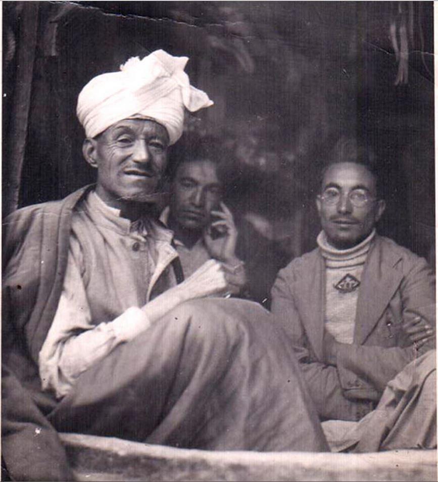 "Munshi Aziz Bhat with his two sons, Munshi Habibullah and Munshi Abdul Rehman. Kargil, Ladakh. 1945. (Photo: <a href=""http://www.indianmemoryproject.com/114/"">Muzammil Hussain Munshi, Kargil, Ladakh</a>)"