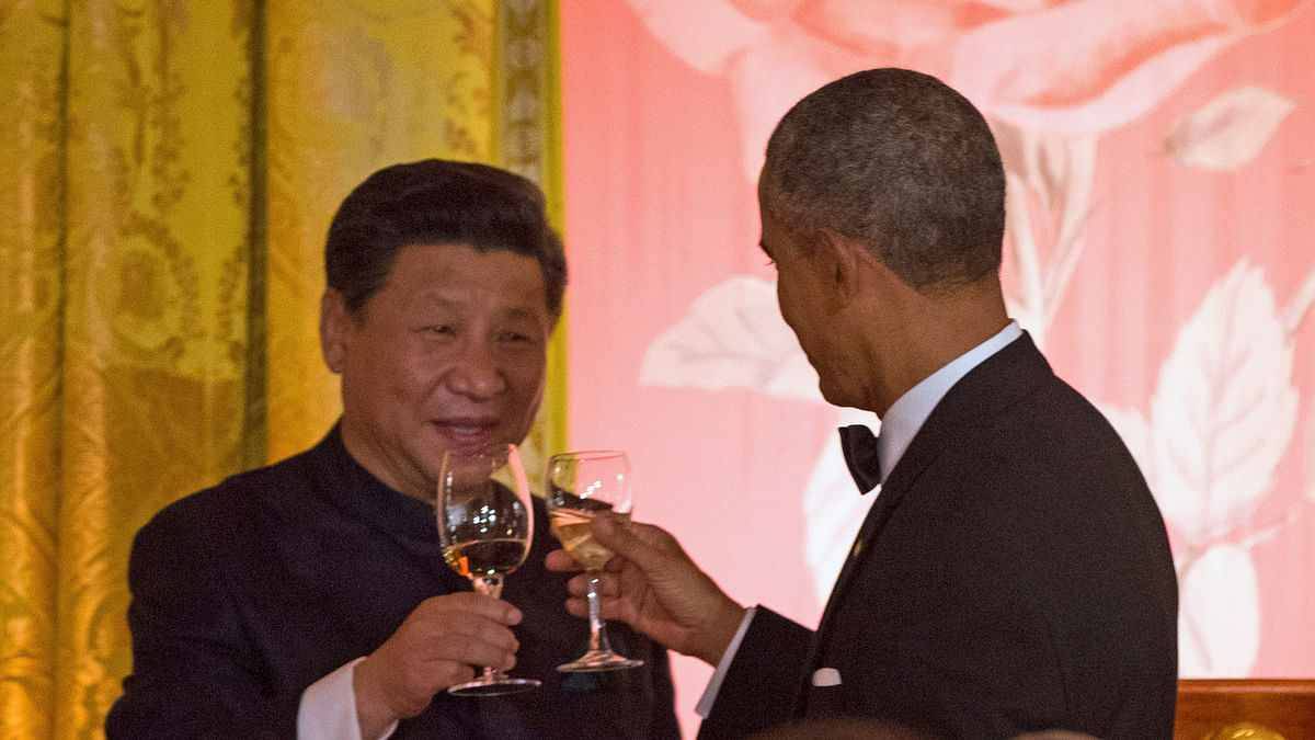 Chinese President Xi Jinping and US President Barack Obama toast during a State Dinner, on Friday, at the White House. (Photo: AP)