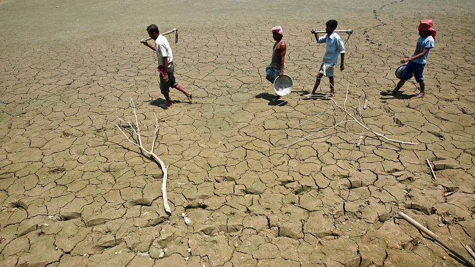 Parched lands of a lake in India. (Photo: Reuetrs)