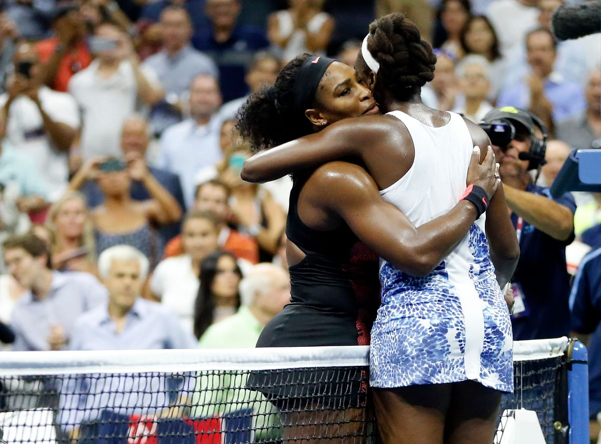 Serena Williams and Venus Williams hug each other after their quarter-final inthe US Open on Tuesday. (Photo: AP)