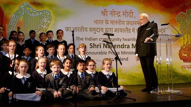 Narendra Modi watching a performance by the children during an interaction with the Indian community in Dublin. (Photo: PTI)