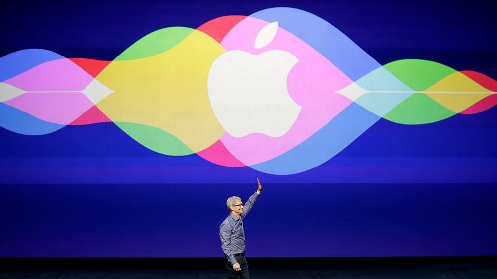 Apple CEO Tim Cook waves during the Apple event in San Francisco. (Photo: AP)