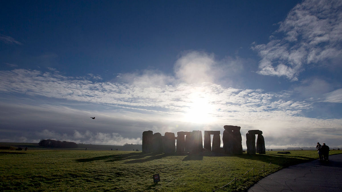 File photo of visitors taking photographs of the world heritage site of Stonehenge, England. (Photo: AP)