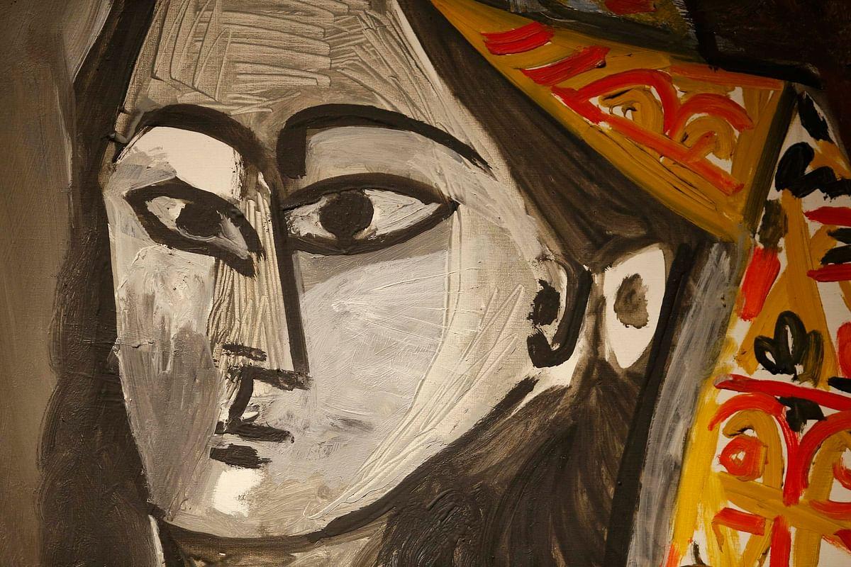"A detail from Pablo Picasso's ""Femme au costume turc dans un fauteuil"", a portrait of his lover Jacqueline Roque painted in 1955, seen at Christie's auction house in London."