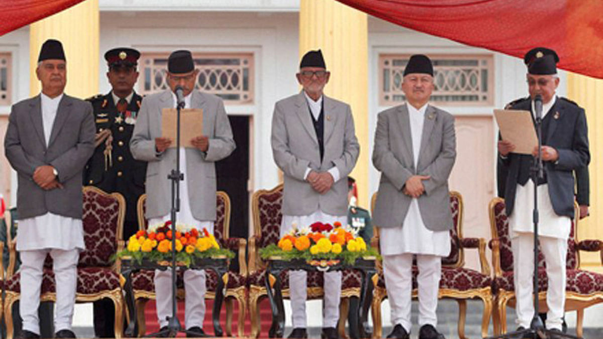 Nepal's President Ram Baran Yadav (second from left), administers the oath of office to newly elected Prime Minister Khadga Prasad Oli (extreme right) at the Presidential building in Kathmandu. (Photo: PTI)