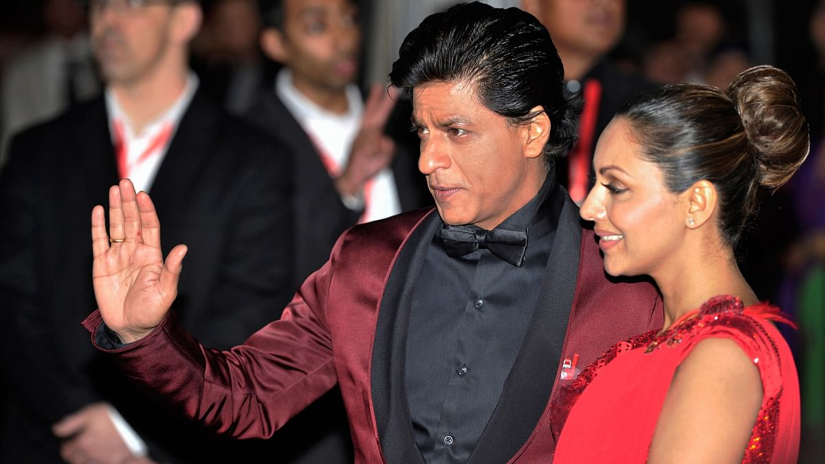 Actor Shah Rukh Khan and his wife Gauri Khan arrive for the inaugural Times of India Film Awards in Vancouver, British Columbia. (Photo: Reuters)