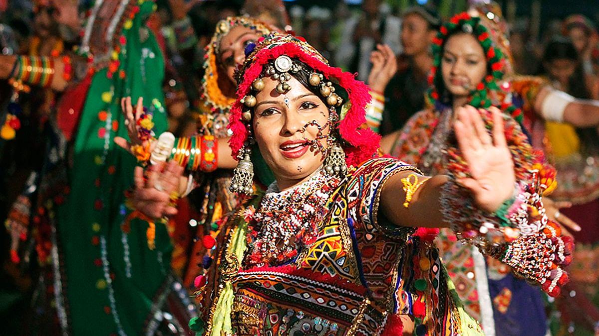An artist in traditional attire performs Garba in Ahmedabad, Gujarat.