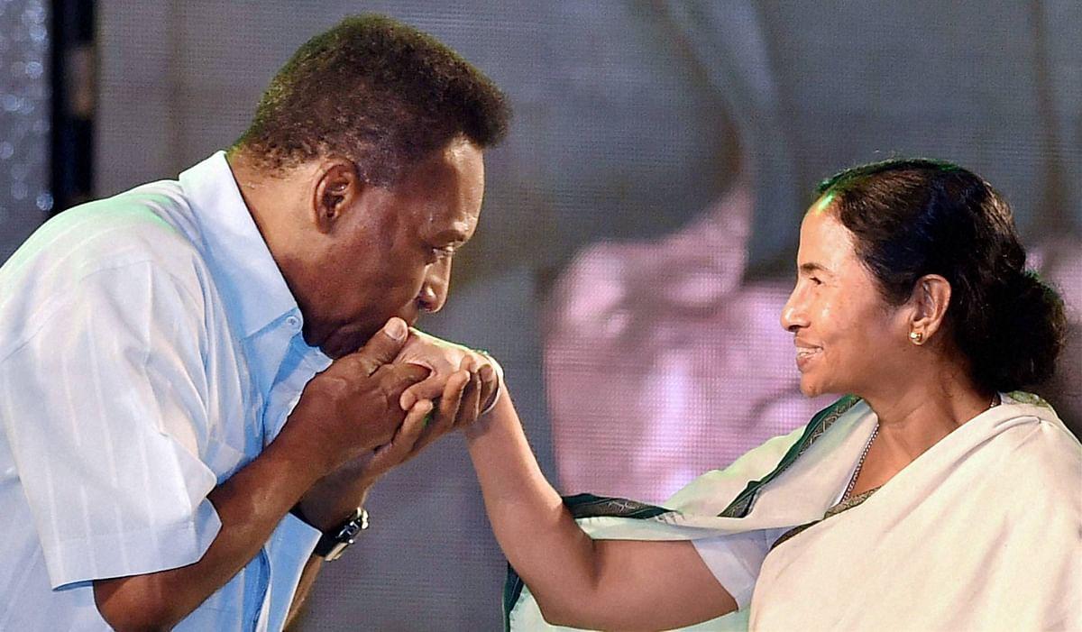 Legendary Brazilian footballer Pele greets West Bengal Chief Minister Mamata Banerjee at a function in Kolkata on Monday. (Photo: PTI)
