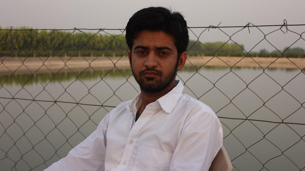 Anuj Kajla, who hails from Panjkosi village, has written off 45 acres of cotton. (Photo: Vivian Fernandes)