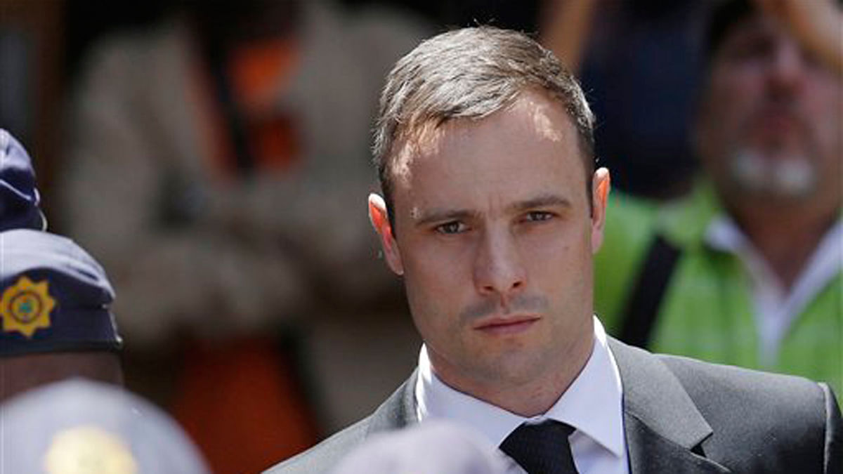 File photo of Oscar Pistorius being escorted by police officers, as he leaves the high court in Pretoria, South Africa.( Photo: AP)