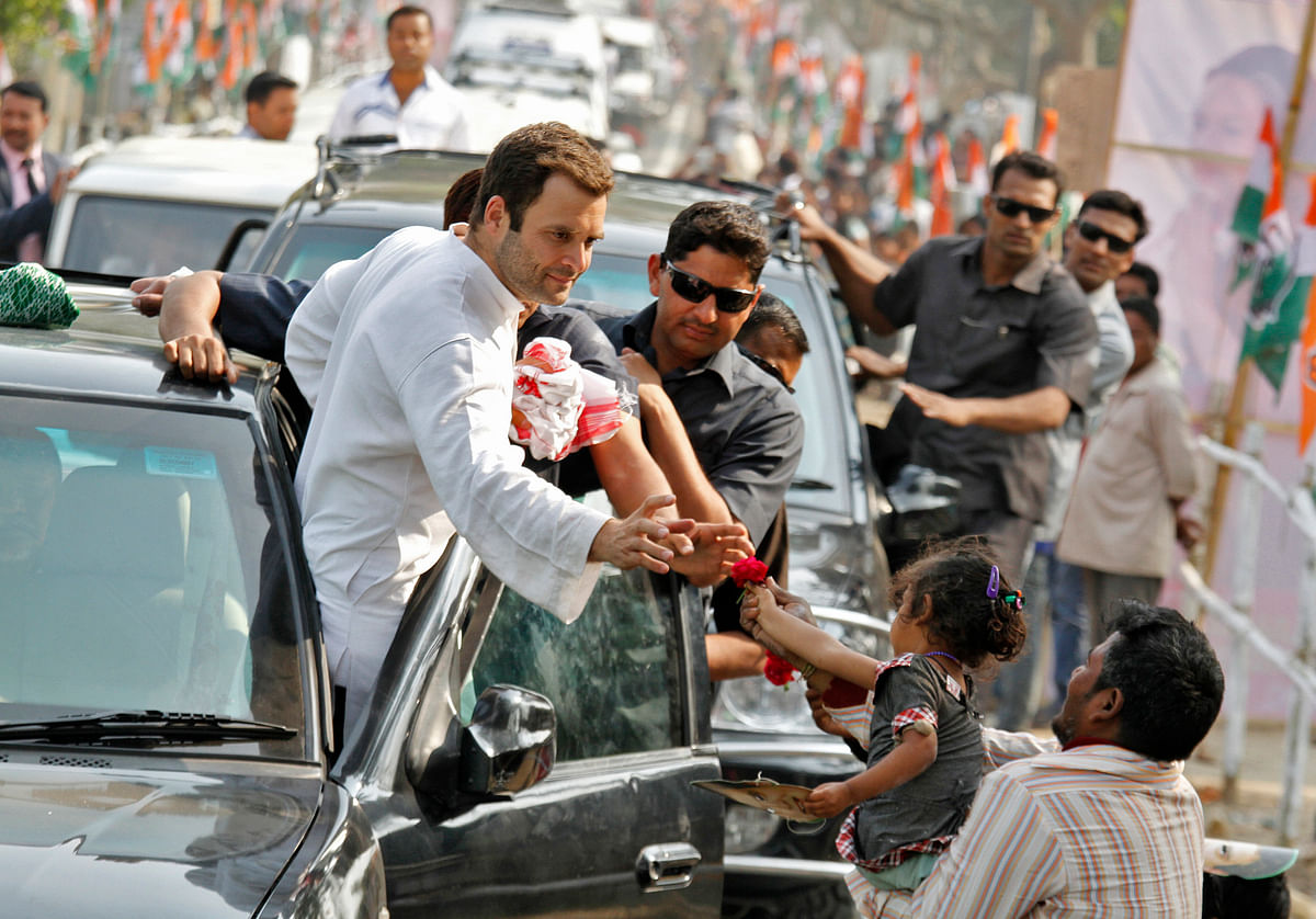 Rahul Gandhi Congress Vice President and son of party chief Sonia Gandhi, receives a flower from a child during a road show ahead of the 2014 general elections. (Photo: Reuters)
