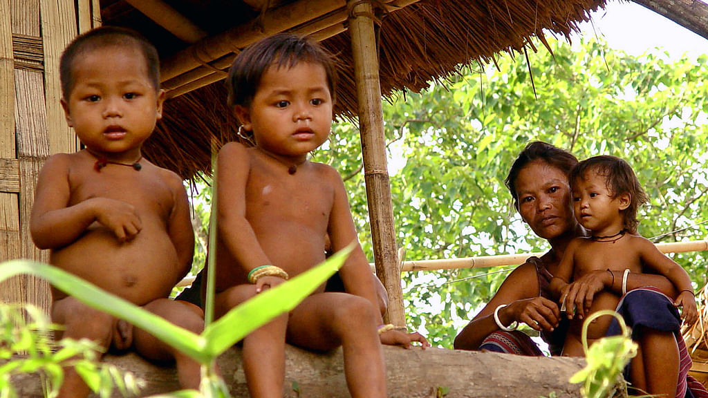 Members of a tribal refugee family of the Reang community in a village near Agartala. (Photo: Reuters)