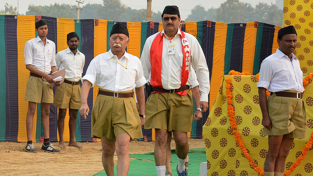 Mohan Bhagwat (3rd L), chief of the Rashtriya Swayamsevak Sangh (RSS), walks after addressing the RSS volunteers. ( Photo: Reuters)