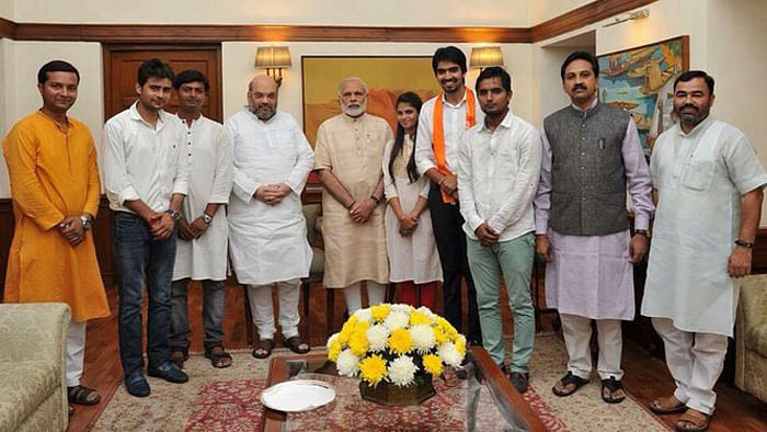 """Satender Awana, fourth from right, pictured here with PM Narendra Modi (Photo: Facebook/<a href=""""https://www.facebook.com/satender.choudhari"""">Satender Awana Abvp I</a>)"""
