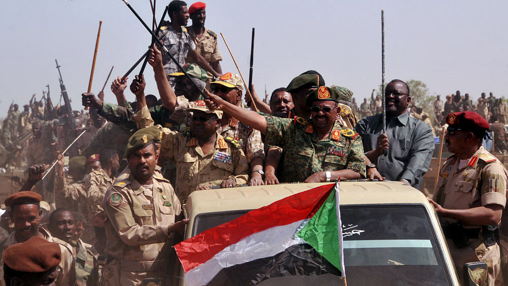 Sudanese President Omar Hassan al-Bashir waves as he leads victory celebrations after the armed forces defeated the rebels in South Darfur, April 28, 2015. (Photo: Reuters)