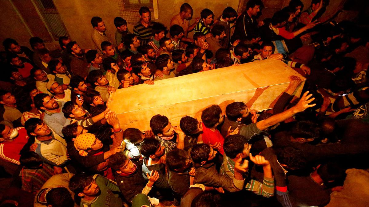 Kashmiri Muslim villagers carrying Zahid Ahmed's coffin in Batango village, Srinagar. (Photo: AP)