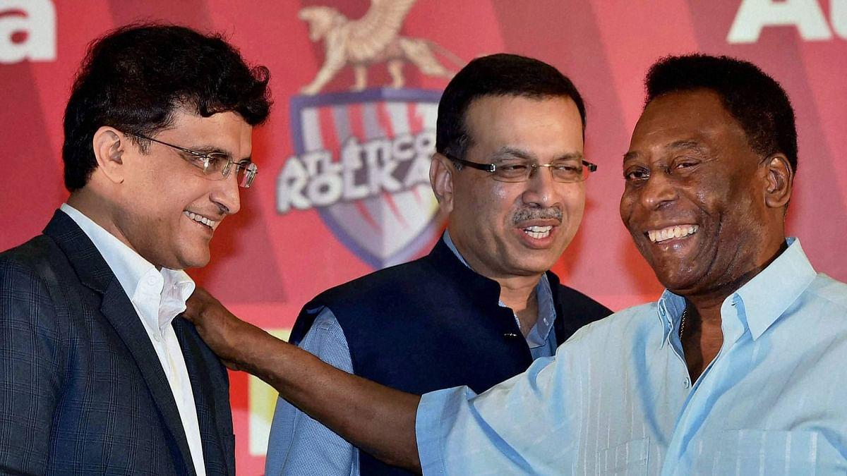 Pele with former Indian captain Sourav Ganguly and Atletico de Kolkata team owner Sanjiv Goenka during an event in Kolkata. (Photo: PTI)